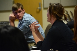 Faculty and staff members ask questions as they acquire advising skills.
