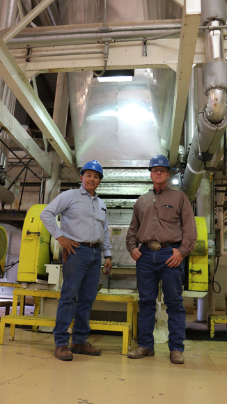 Geronimo Ortega (left) runs the mill and Randy Shields (right) manages Wrangler Feedyard.
