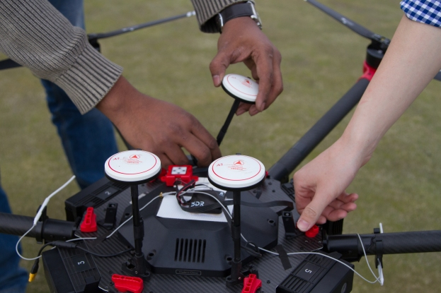 [Left to Right] Graduate students Abir Raihan and Yazhou Sun make last minute adjustments before the drone takes flight. Raihan and Sun are two research assistants who assist Wenxuan Guo Ph. D., in his research.